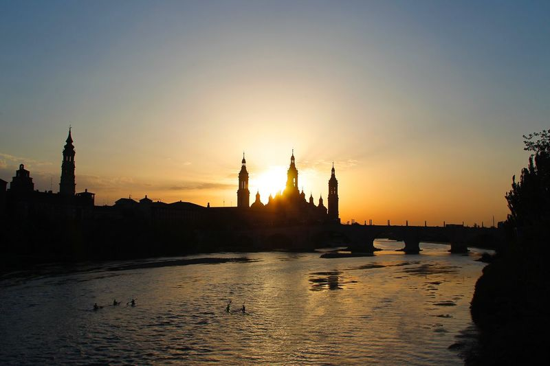 Zaragoza Catedral Ebro River Virgen Del Pilar Sunset Sky Water Silhouette Orange Color Nature Beauty In Nature Architecture Reflection Scenics - Nature Waterfront Tranquility Built Structure No People Idyllic Tranquil Scene Travel Destinations Clear Sky Sunlight Outdoors