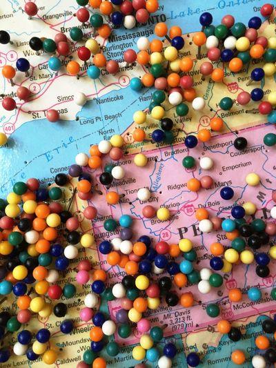 High angle view of thumbtacks on world map