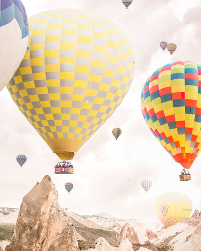 Cappadocia Hot Air Balloon Multi Colored Flying Ballooning Festival Mid-air Adventure Air Vehicle Outdoors Sky Turkey Cappadocia Cappadocia Hot Air Ballons Paint The Town Yellow