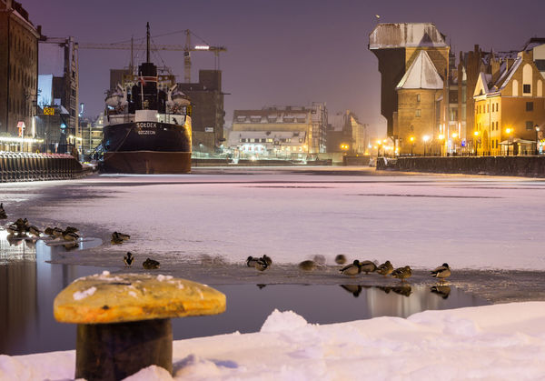 Reflection City Night Illuminated No People Outdoors Water Architecture Urban Skyline Downtown District Cross Section Cityscape Sky Skyscraper Gdansk Winter Old Harbour Ship Harbor Tranquility Cold Temperature Snow Landscape