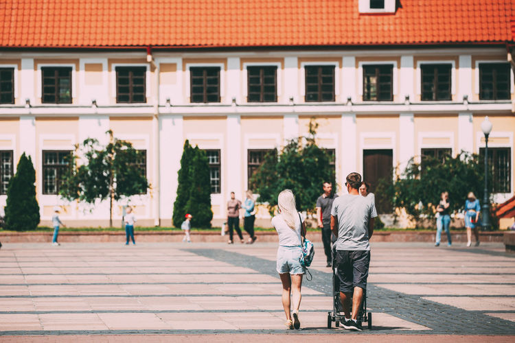 Grodno, Belarus - June 11, 2017: Young Family Couple With A Stroller Walking Near Old House Of Vice - Administrator In Sunny Summer Day In Hrodna, Belarus Grodno Hrodna Architecture Belarus Building City Historic House Landmark Man People Street Summer Sunny Tourism Town Travel Urban Woman Young Family Stroller Administrator