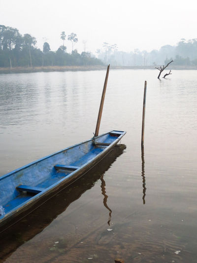 Beauty In Nature Blue Boat Day Lake Laos Mode Of Transport Nature Nautical Vessel No People Outdoors Outrigger Reflection Sky Water