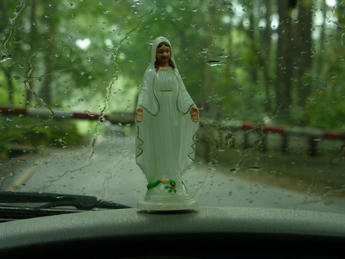 Close-Up Of Virgin Mary Statue In Car