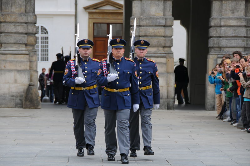 changing the guards Adult Adults Only Changing The Guards Day Headwear Men Military Uniform Outdoors People Performance Group Prague Prague Palace Teamwork Uniform