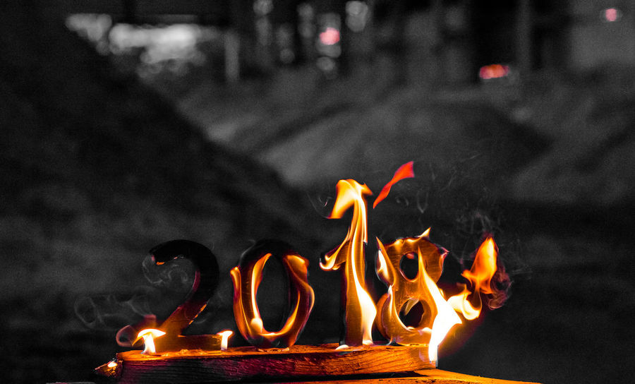 Wooden figures 2018 are burned in a flame. Conceptual photo end of the year. NewYear Bonfire Burning Close-up Communication Dusk Fire Fire - Natural Phenomenon Flame Focus On Foreground Glowing Heat - Temperature Illuminated Motion Night No People Orange Color Outdoors Wood - Material