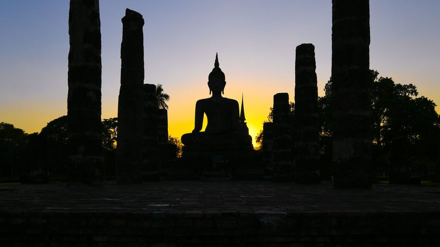 Statue of temple at sunset
