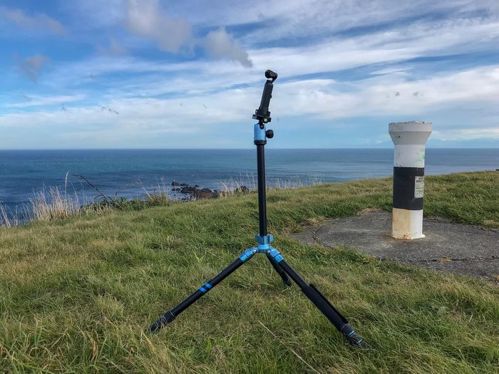 Tripod Photography Tripod Sky Water Sea Cloud - Sky Horizon Over Water Horizon Beauty In Nature Tranquility Tranquil Scene Grass No People Guidance Beach Green Color Outdoors Scenics - Nature Nature Land Day Plant