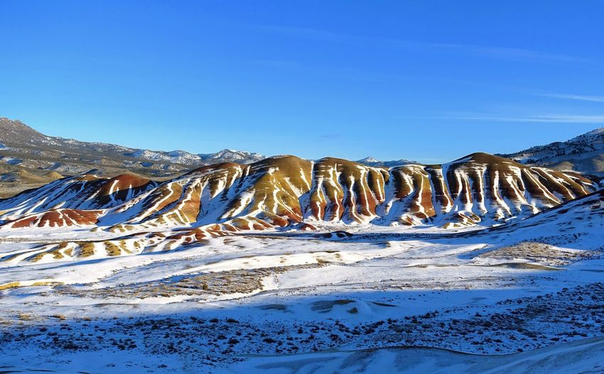Snow melting on the Painted Hills of Oregon Snowcapped Mountain Idyllic Non-urban Scene Mountain Clear Sky No People Tranquility Nature Winter Tranquil Scene Scenics - Nature Beauty In Nature Cold Temperature Snow John Day Fossil Beds National Monument Oregon Oregon Beauty Scenic View Travel Destination Travel Photography National Park