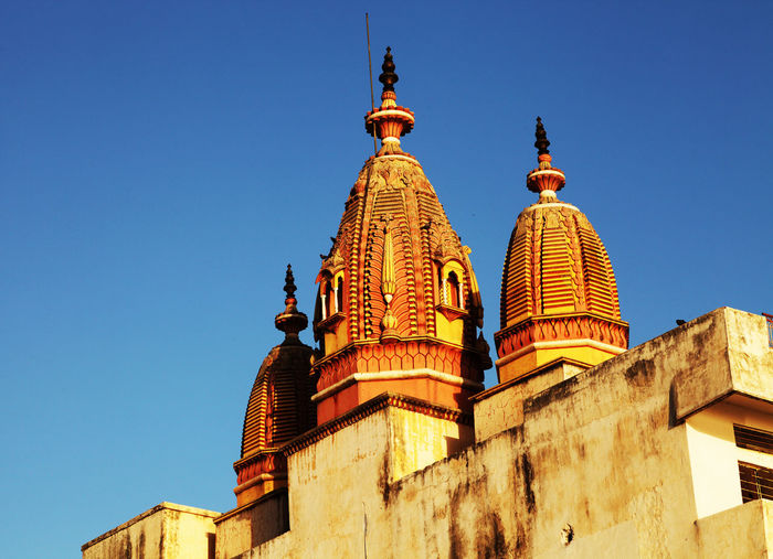 High Section Of Temple Against Clear Blue Sky