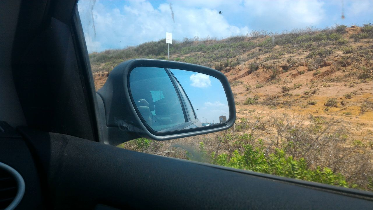 side-view mirror, car, transportation, mode of transport, land vehicle, car interior, sky, landscape, day, nature, window, no people, beauty in nature, outdoors, tree, close-up, grass