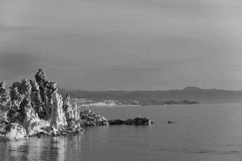 Black and white landscape of vertical rock formations or tufa formations on Mono Lake Black And White Tufa Mono Lake EyeEm Selects Water Sea Sky Beauty In Nature Scenics - Nature Nature Tranquil Scene Beach Day Land No People Outdoors Waterfront Rock Non-urban Scene Idyllic Rock Formation Tranquility Mountain