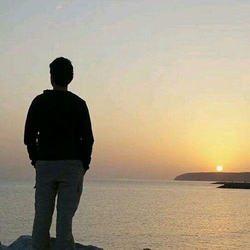 Watching sunrise on a fishing trip. My good life in Oman