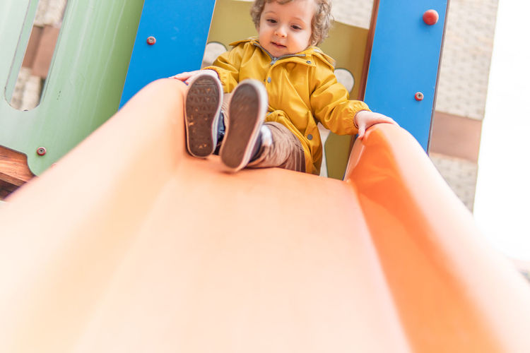 Portrait of boy sitting at playground