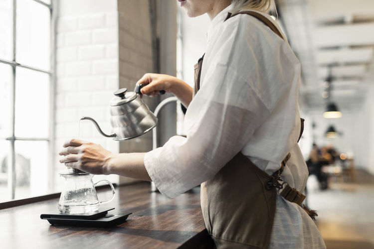 Side view of woman with coffee