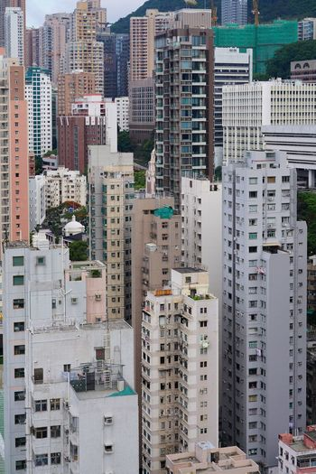 High angle view of buildings in city, hong kong
