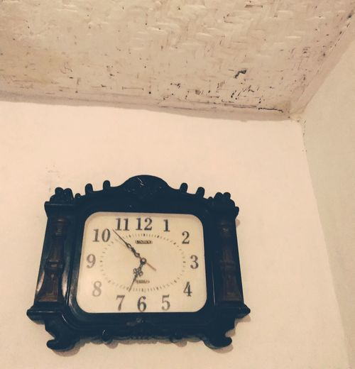 High angle view of clock on wall