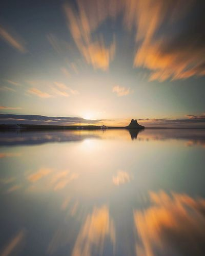Cloud Burst Reflection Sky Water Tranquil Scene Beauty In Nature Nature Sea No People Scenics Cloud - Sky Horizon Over Water Tranquility Idyllic Waterfront Built Structure Outdoors Sunset Calm Architecture Day Castle Lindisfarne Northumberland Long Exposure The Great Outdoors - 2017 EyeEm Awards