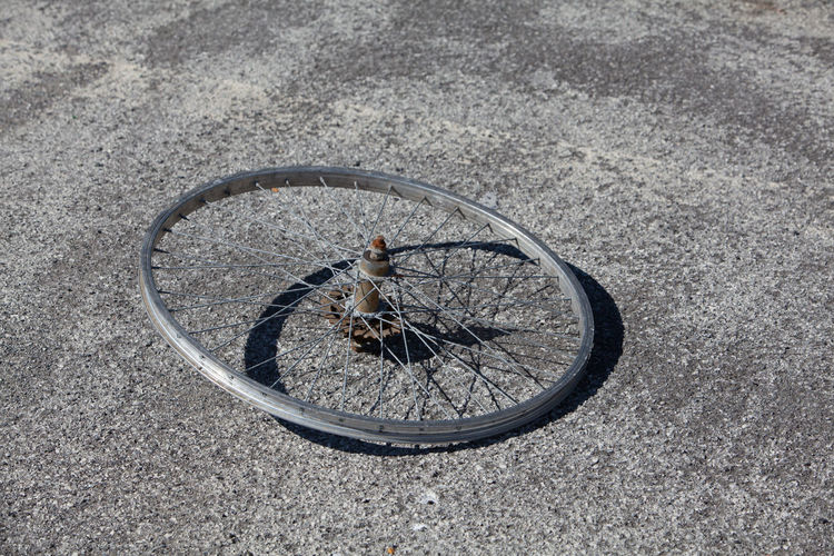 High angle view of abandoned bicycle wheel on street