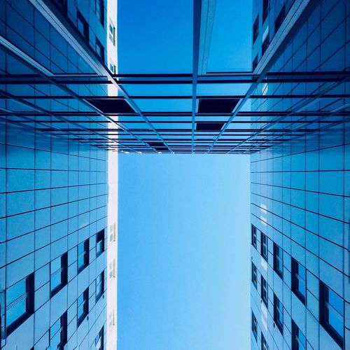 Into the blue. Architecture Building Exterior Built Structure Blue Modern Skyscraper City Clear Sky Low Angle View Façade Office Workplace Urban Geometry Urbanphotography Urban Discover Your City Architecturelovers Copy Space Hamburg Windows Looking Up
