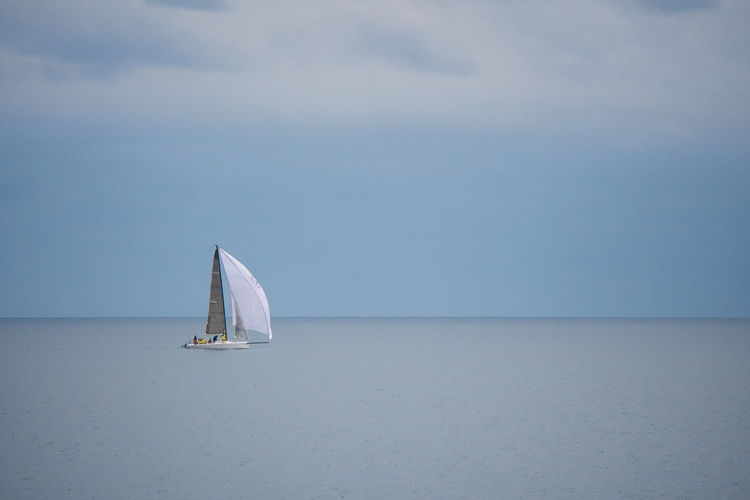 Sailing on Lake Ontario. Alone Calm Relaxing Beauty In Nature Boat Clouds Day Horizon Over Water Lake Nature Nautical Vessel Outdoors Peaceful Sailboat Sailing Scenics Sea Sky Solo Tranquility Transportation Water Be. Ready. Step It Up Visual Creativity The Great Outdoors - 2018 EyeEm Awards