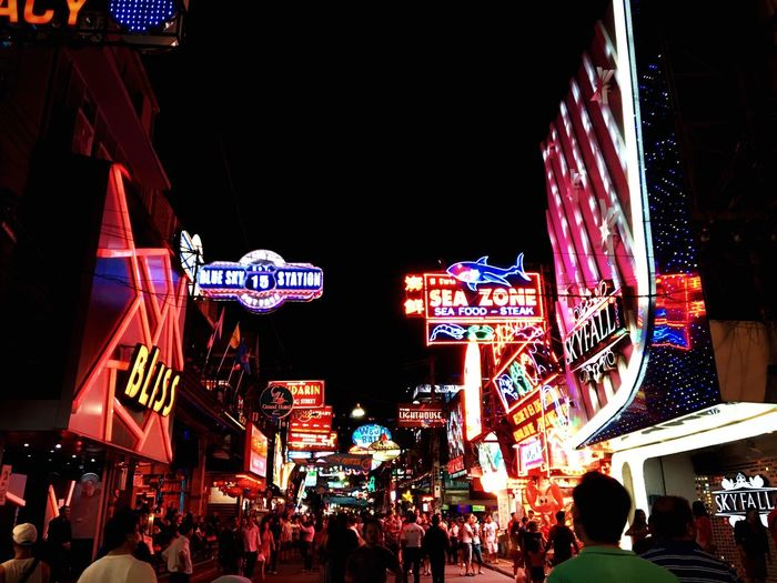 Night Illuminated City Building Exterior Non-western Script Neon Text Architecture Street Advertisement Commercial Sign Communication Built Structure City Street City Life Dark Outdoors Sky Neon Light Group Of Objects Pattaya Thailand Walking Streets City Life First Eyeem Photo