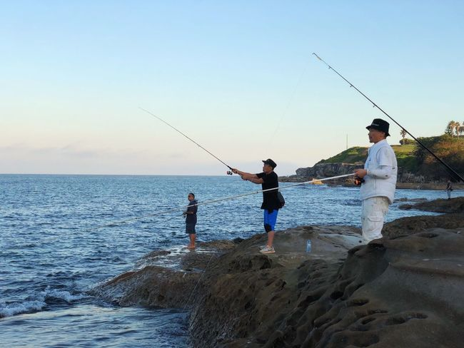 Fishing Family Activity Bonding Fishing Fishing Rod Group Of People Hobby Leisure Activity Lifestyles Men Real People Sea Sky Water
