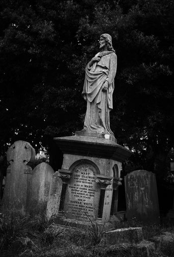 Graves found in the Hampstead Cemetery, London, UK. Jesus Christ Angel Art And Craft Belief Black And White Cemetery Grave Human Representation Memorial No People Outdoors Religion Representation Sculpture Statue Stone Tombstone