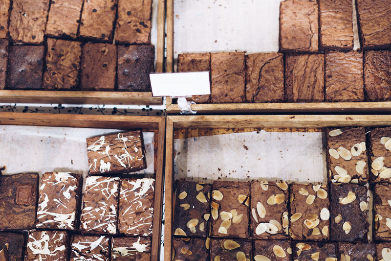 Directly above shot of chocolate brownies for sale at bakery