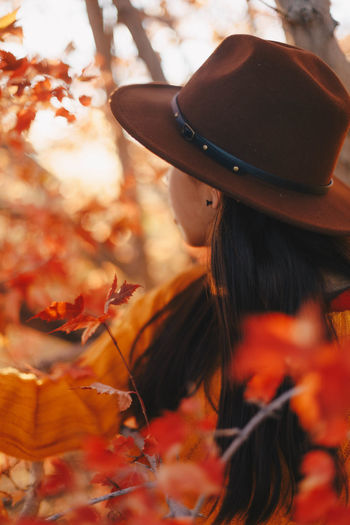 Portrait of woman with autumn leaves
