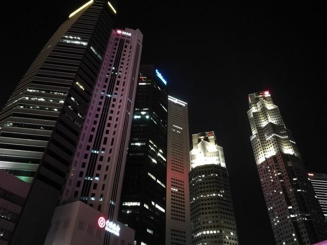 Skyscraper Night Illuminated Architecture Cityscape Modern City Downtown District Urban Skyline Building Exterior Business Finance And Industry Travel Destinations Business Singapore City