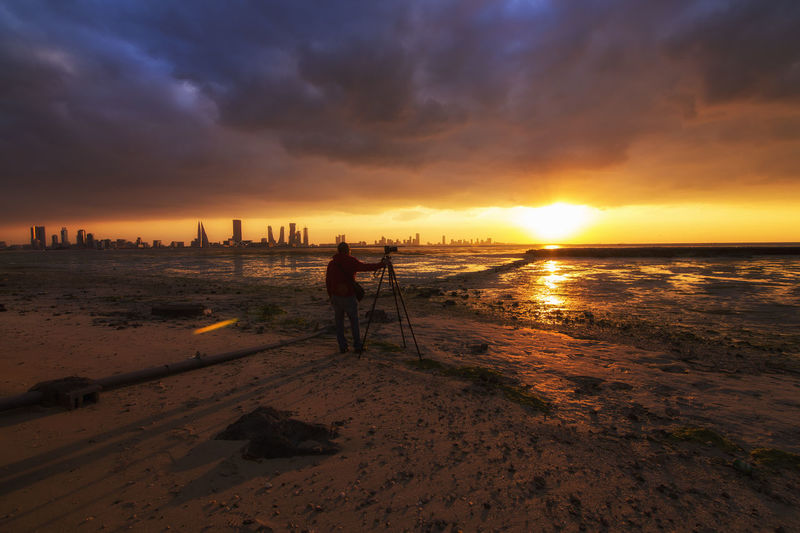 Arabian Bahrain Bahrain Tourism Bautiful Beauty In Nature Camera - Photographic Equipment Cityscape Cloud - Sky Contrast Landscape Man Man Watching The Sunset Middle East Photographer Seascape Sunset Tranquility Travel Destinations Traveling Tripod Visitbahrain