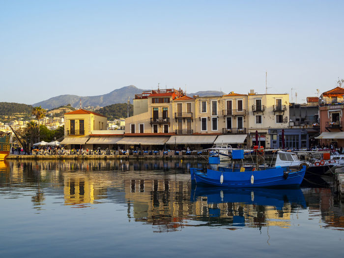 Harbour at Rethymno Crete with the mountains in the background as the sun goes down Boats Buildings Colorful Harbor Harbour Holiday Reflection Sunset Tranquil Scene Travel Destinations Vacations Water