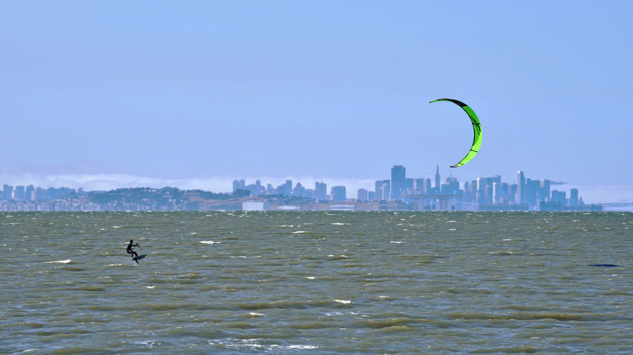 Kiteboarding In San Mateo 22 San Mateo, Ca. The Color Of Sport Kitesurfers Kiteboarding San Francisco Skyline Cityscape Waterfront San Francisco Bay Wind Power Watersports Aquactic Sports Board Sports Colorful Sails Kites Wetsuits Athletes Leisure Activity Enjoying Life Marine Layer Fog Urban Skyline Skyscrapers Nature Beauty In Nature Nature_collection