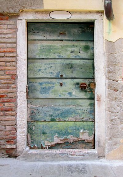 Venice, Italy Wooden Door Weatheredwood Old Door Scratched Door Green Door Stone Frame Architectural Detail Brick And Mortar Concrete Plaster Wall