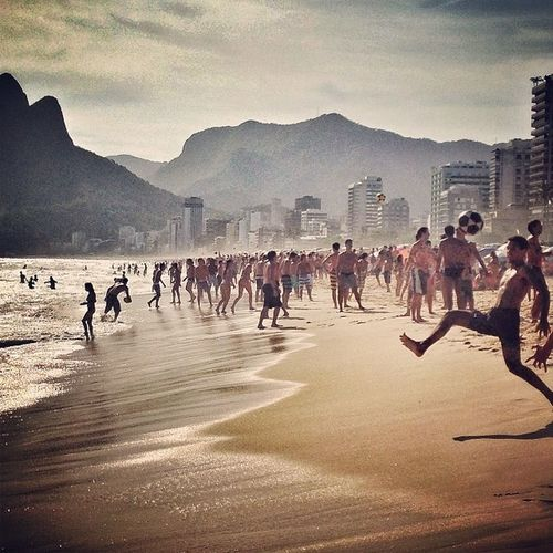 A typical scene in Riodejaneiro people playing kick ups on Ipanema beach