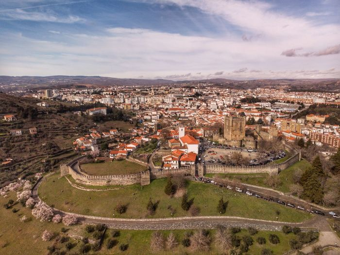 The castle of Bragança above the city DJI X Eyeem DJI Mavic Air Drone Photograph Architecture Building Exterior Built Structure City High Angle View Cloud - Sky Cityscape Landscape Environment Plant Aerial View Day Town Residential District Outdoors Crowded Community Sky Building Nature