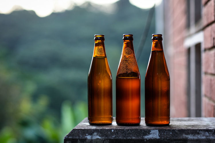 Bottles Alcohol Beer - Alcohol Bottle Bottles Brown Brown Bottles Day Drink Focus On Foreground Food And Drink No People Outdoors