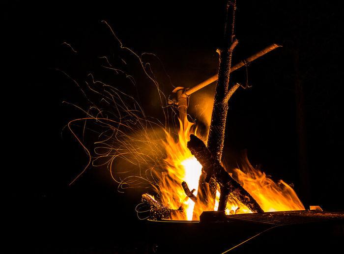 Close-up of illuminated bonfire at night