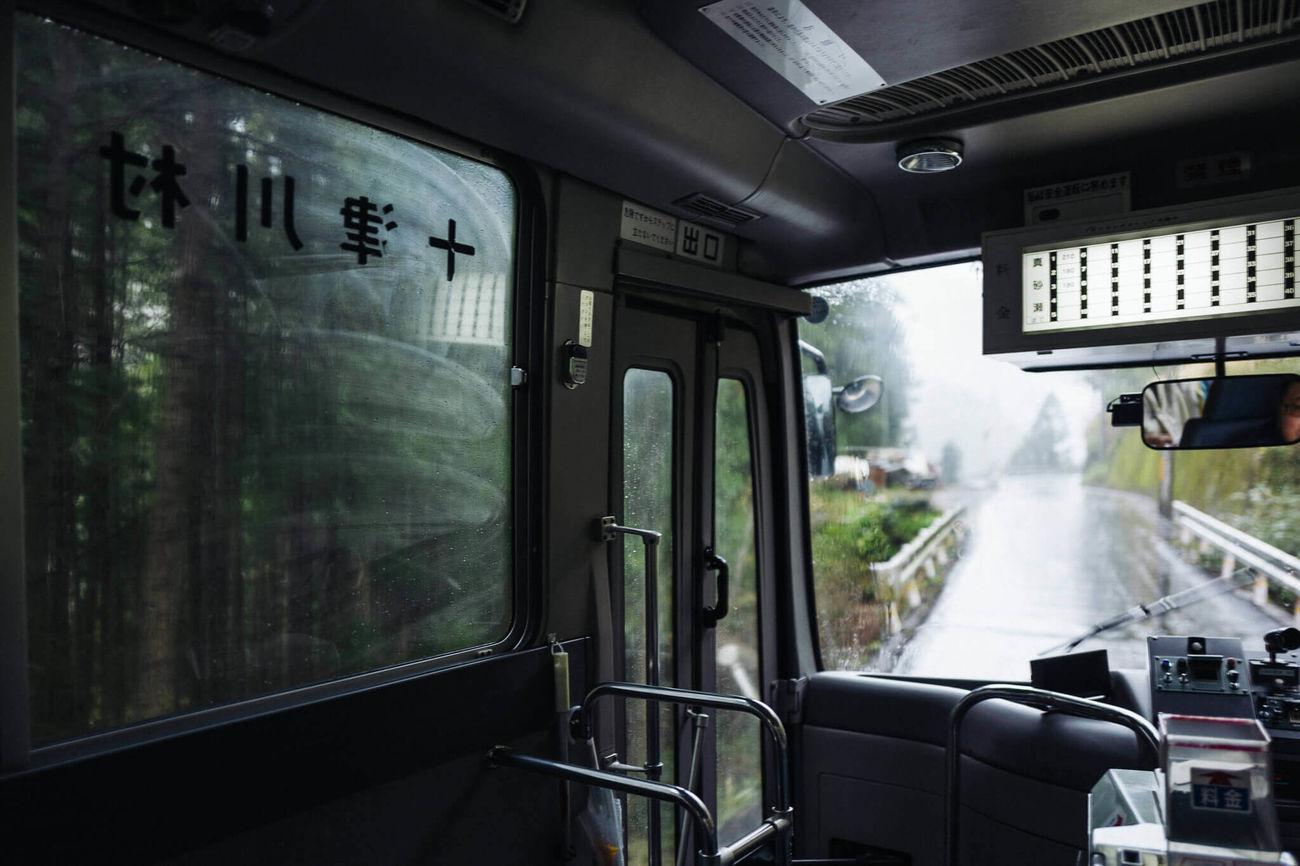 TRAIN MOVING ON RAILROAD STATION PLATFORM