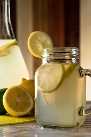 Close-Up Of Lemonade In Jar On Table