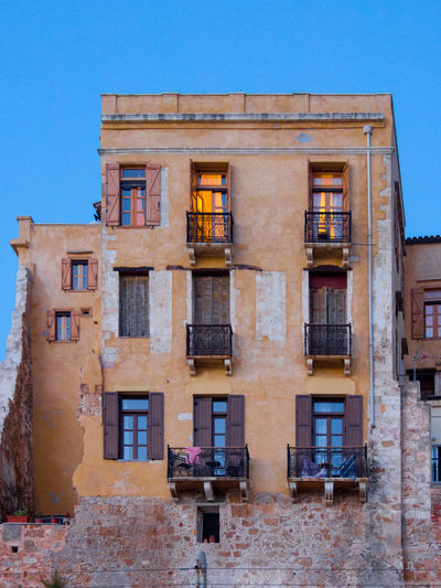 Traditional residential building at the Chania Old Harbour front, at sunset Crete Greece Balcony Building Exterior Clear Sky History Low Angle View No People Old Old Harbour Sunset Wall
