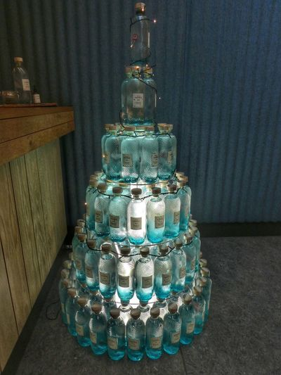 Harris Gin Christmas Tree Tarbert Festive christmas tree Christmas Decoration Gin And Tonic Harris Gin Isle Of Harris VisitScotland Indoors  No People Still Life Wealth Pattern Decoration Wall - Building Feature Blue Creativity Illuminated Ornate