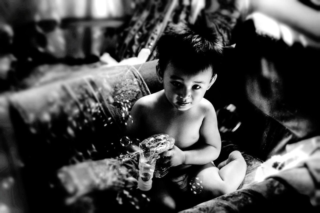 CLOSE-UP PORTRAIT OF SHIRTLESS BOY