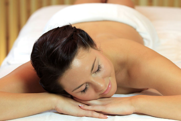 Young woman relaxing with a massage Beautiful Wellness Woman Alternative Therapy Beauty Beauty Spa Body Care Eyes Closed  Girl Health Spa Healthy Leisure Activity Lifestyles Massage Massage Table Massage Therapy Pampering Relax Relaxation Spa Spa Treatment Treatment Wellbeing Young Adult Young Women