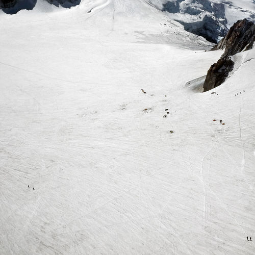 Miniscule hikers on the Mont Blanc glacier Glacier Mont Blanc Hikers Climbers Man And Nature White Copy Space Power Of Nature Environment Environmental Conservation Environmental Issues Mountain Alps Italy France Mountaneering Sense Of Scale Ice
