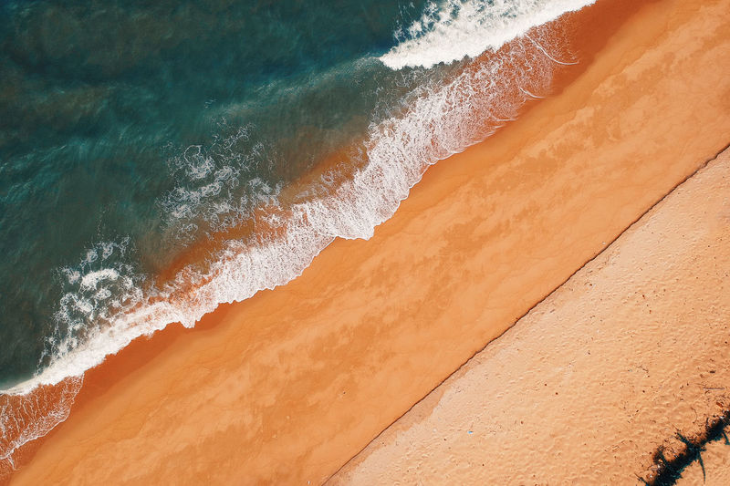 Aquatic Sport Beach Beauty In Nature Day High Angle View Land Motion Nature Non-urban Scene Outdoors Power In Nature Sand Scenics - Nature Sea Sport Surfing Water Wave