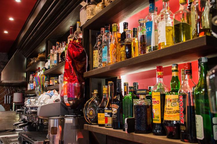 Panoramic shot of bottles on display
