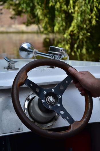 Man steering a ship in Gent, Belgium Boat Close-up Day Finger Focus On Foreground Hand Holding Human Body Part Human Finger Human Hand Leisure Activity Lifestyles Metal Mode Of Transportation Nautical Vessel One Person Outdoors Real People Ship Steering Wheel Steering Wheel Ship Transportation Unrecognizable Person Water Wooden Steering Wheel