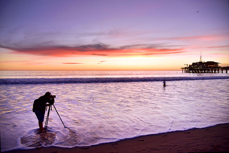 Adventure Beach Beauty In Nature Camera - Photographic Equipment Cloud - Sky Full Length Lifestyles Men Nature One Man Only One Person Outdoors Photographer Photographing Photography Themes Real People Scenics Sea Silhouette Sky Sport Standing Sunset Vacations Water