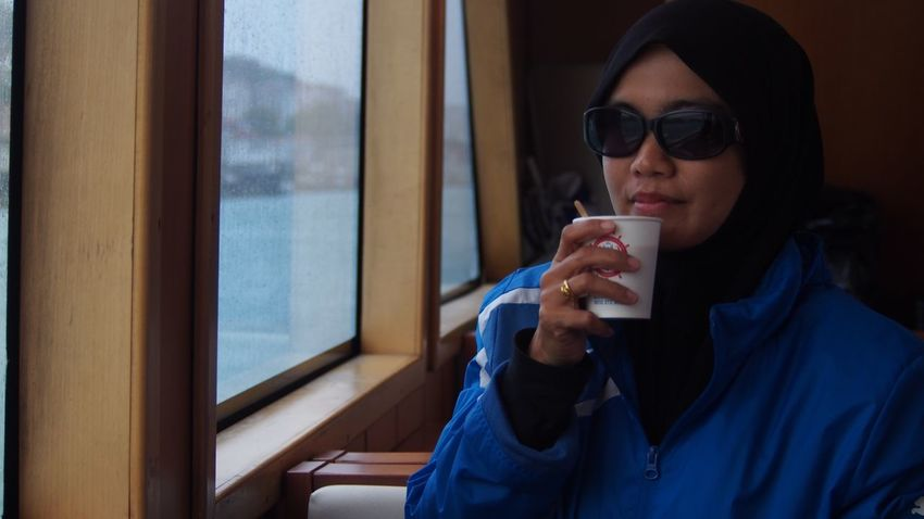 A ladies tourist drinking hot coffee in a cruise on the Bosphorus Strait, Istanbul, Turkey Adult Ocean Blue Boat Bosphorus, Istanbul Istanbul Alone EyeEm Selects Sunglasses Young Adult Young Women One Person Real People Drinking Drink Window Coffee Cup Coffee - Drink Front View Leisure Activity Lifestyles Refreshment Holding Food And Drink Beautiful Woman Day Sitting